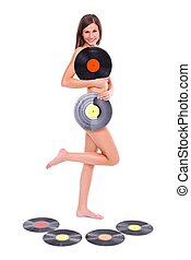 Nude girl with vinyl discs - Nude girl standing with vinyl...