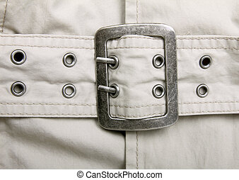 Trench coat with matel belt , close up, background