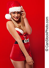 Blond woman in sexy Santa outfit