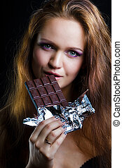 sexy young woman eating chocolate