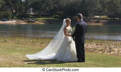 Bride Groom Talking - Bride in formal wedding gown and groom...