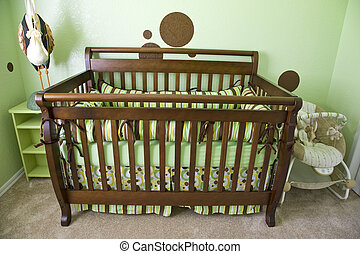 Babies Room - A babies room with green walls and brown dots