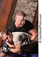 Mixed Martial Artists Fighting - Two male mixed martial...