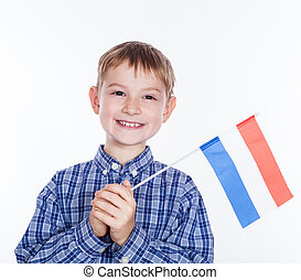 A little boy with Dutch flag on the white background