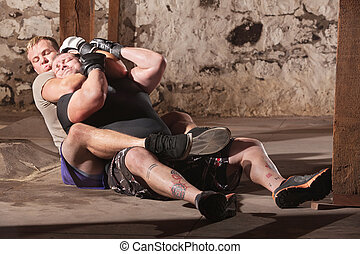MMA Fighters in Choke Hold Training - Two men training in...
