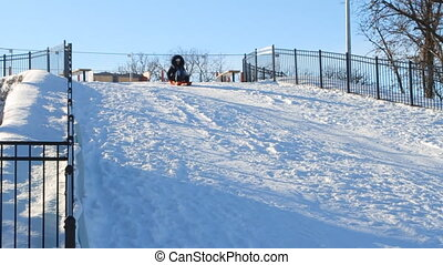 Woman sledding in the winter - Woman having fun sledding...