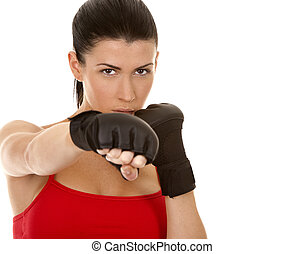 fitness woman - athletic brunette wearing boxing gloves on...