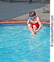 Caucasian Boy Doing Cannon Ball in Pool - This 8 year old...