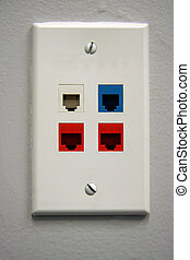Telephone Outlet - A white telephone data outlet with 4...
