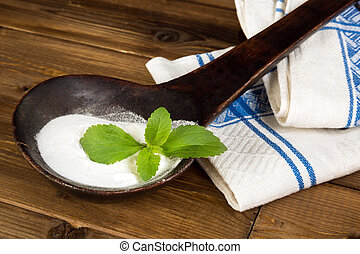Old spoon with fresh stevia leaf - Old spoon with natural...