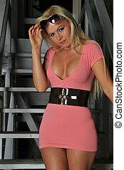 Blonde - Beautiful blonde in a pink dress with a black belt