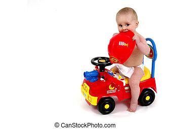 Infant sitting on push toy