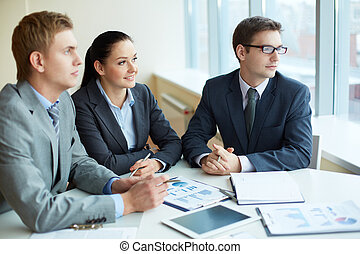 Pensive employees - Image of three business people looking...