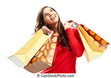 Happy shopper - Portrait of happy girl with colorful paper...