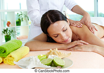 On massage table - Photo of a girl lying on the massage...