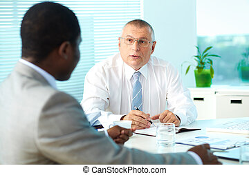 Boss and employee - Portrait of senior boss talking and his...