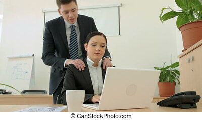 Business tenderness - Careful manager giving his lovely...