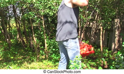 starts chainsaw - male starts a chainsaw