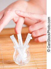 Acupuncture needles and hands pointing on special point Hegu