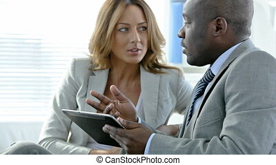 Touchpad business - Close-up of partners discussing business...