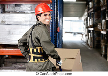 Warehouse Worker Pushing Handtruck With Cardboard Boxes -...