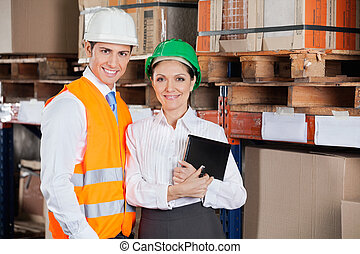 Confident Young Supervisors At Warehouse