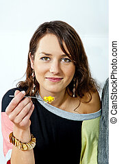Woman eating a cake