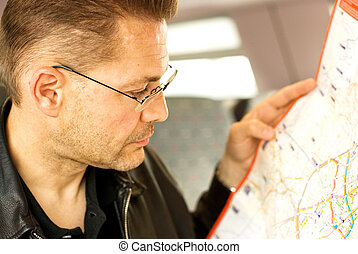 Serious man looking at a map