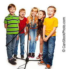 Group of kids singing to microphone standing together,...