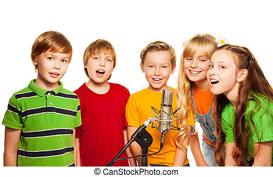 Group of 8 years old kids with microphone - Group of 5 happy...