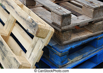 Wooden pallets - detail of a stack of wooden pallets