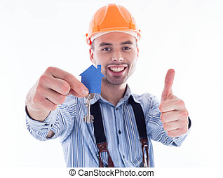 A builder man holding a key and a paper house.