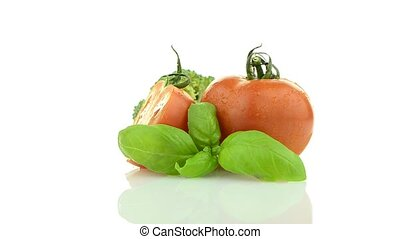 Vegetables still life rotating isolated on white background
