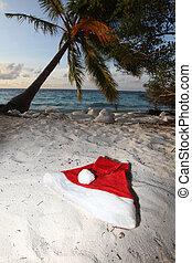 santa claus hat on beach