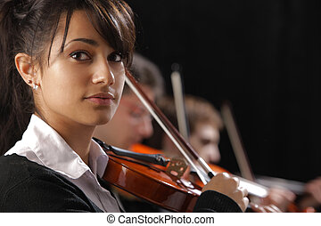 Classical music concert: Portrait of young woman violinist