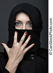 Manicure - Woman in black ninja dress with manicure