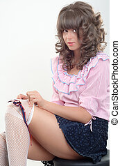 Playing innocent - Sexy girl arrange his socks
