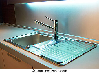 Tap in modern kitchen - Modern stainless steel tap in white...