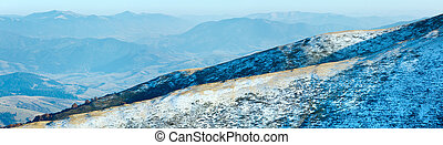 Autumn  mountain panorama with first winter snow