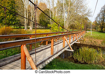 pedestrian bridge over a small river