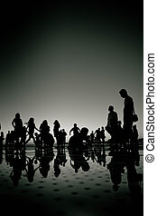 People silhouette reflections black and white on Zadar...