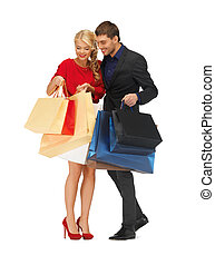 man and woman with shopping bags - bright picture of man and...