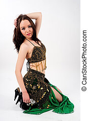 Belly dancer - Beautiful girl in belly dance costume on a...