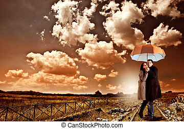 Prepared for storm - Couple under and umbrella is prepared...