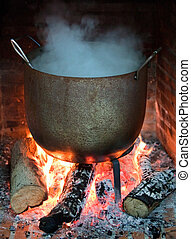Cooking food in a pot on the fire