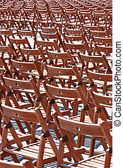 Wooden chairs before concert pattern empty no people