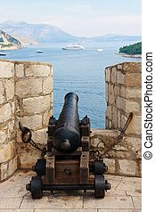 Cannon pointing at cruise ship, Dubrovnik walls, Croatia