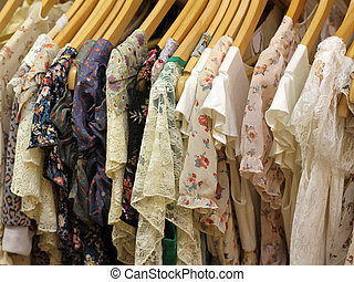 Dresses - Floral design summer dresses on hangers on store...