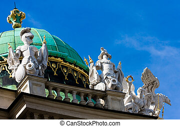 Roof top details depicting marble knights with coat of arms...