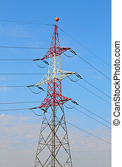 Electrical Tower / Utility Pole / Power Pole before cloudy blue sky